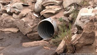 Fig. 3. Corrugated metal culvert drain pipe. Culverts provide cross drainage for roads with inside ditches. Photo: R. Lucas.